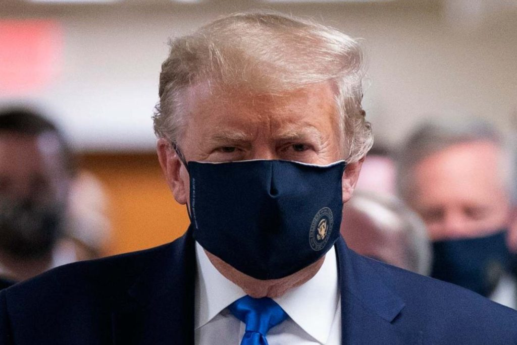 President Donald Trump wears a face mask